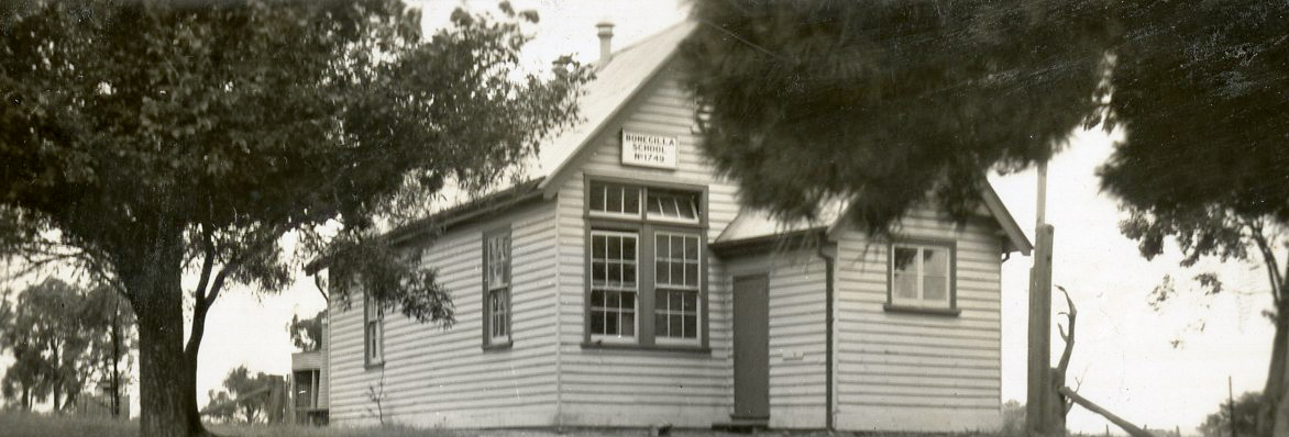 Black and white photo of an old school building