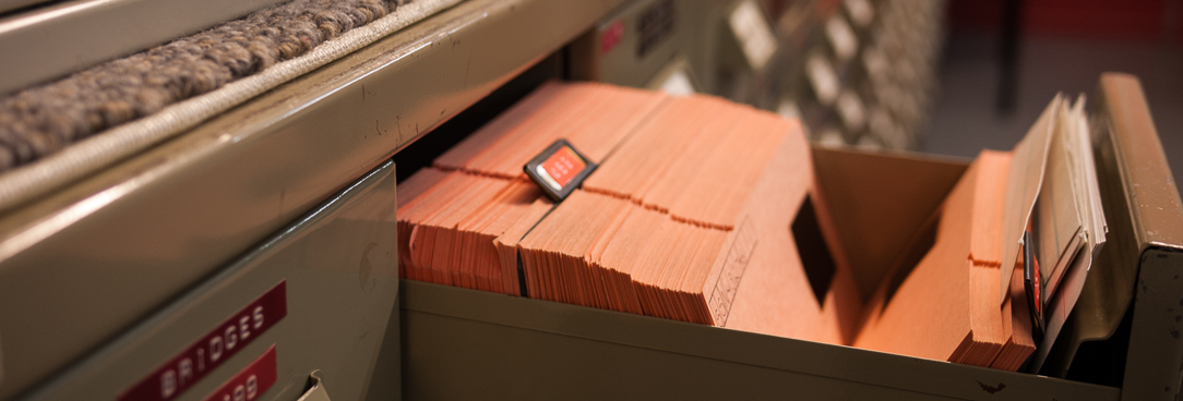 An open drawer holding microfilm records