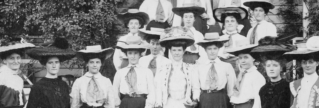 A black and white photo of a group of women