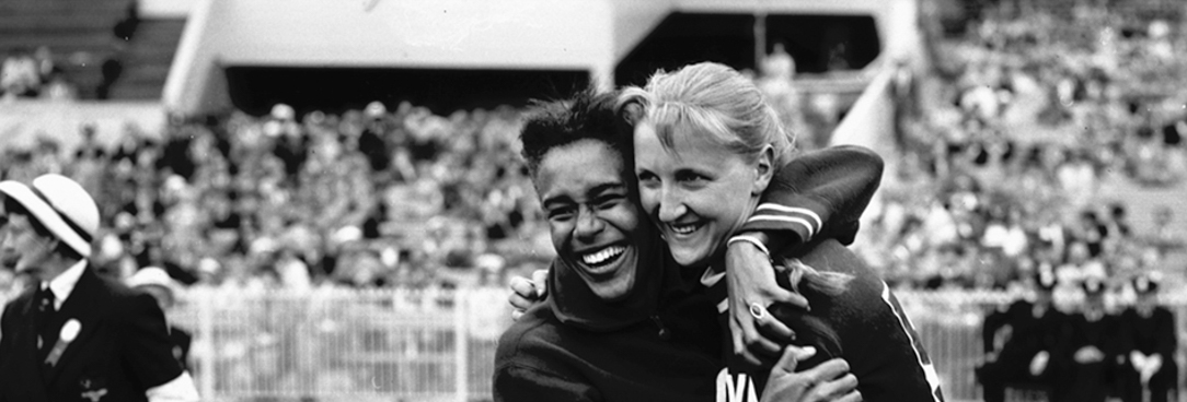 Black and white image of two Olympians hugging from 1956 olympics