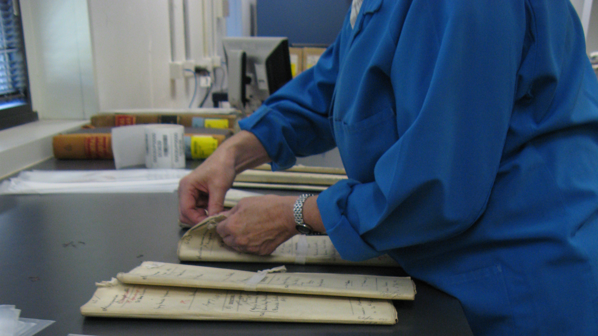 Image of archivist handling records