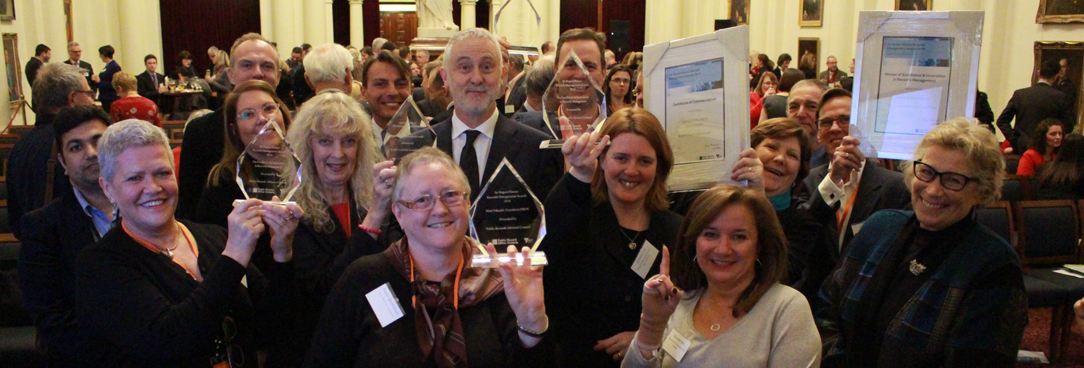 Photo of happy award winners with their trophies