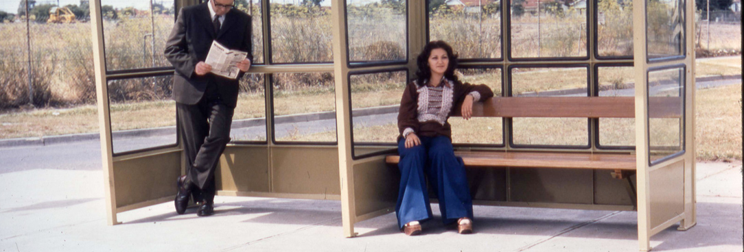 Woman sits at bus stop VPRS12907P4Unit7