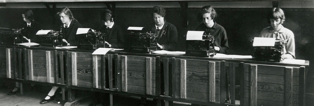 girls in a line with typewriters