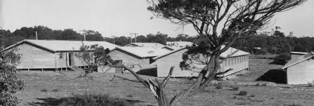 Rowville camp buildings, from the Argus newspaper collection of war photographs, World War II, originally captioned 'Rosehill (Dandenong) camp, these huts at present empty', c. 1945, State Library Victoria, Pictures Collection, H99.201/410