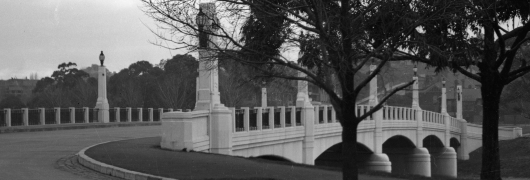 Black and white photo of bridge over river