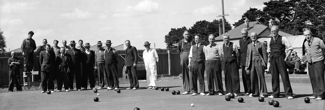 black and white photo of men playing law bowls