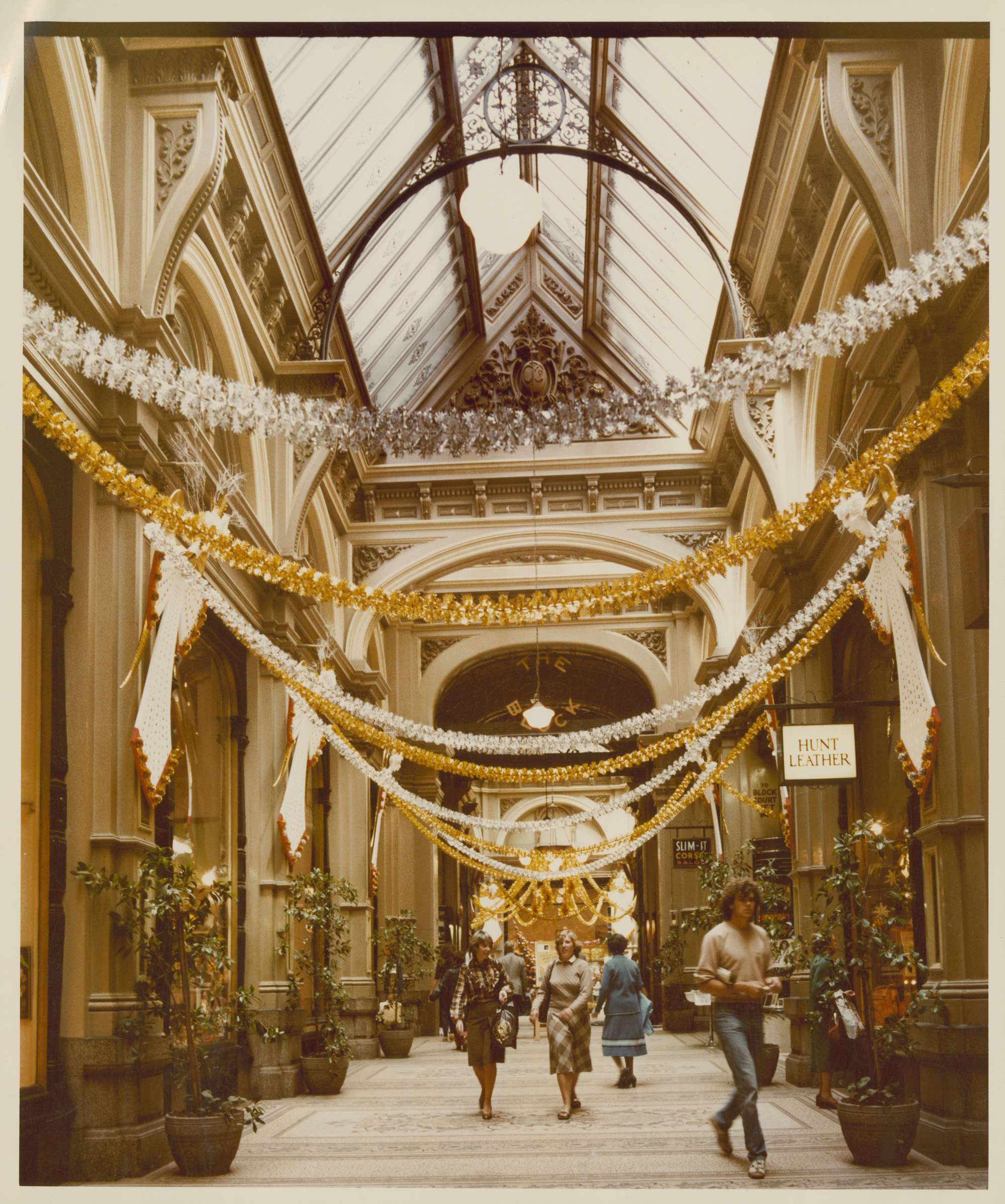 photo of shopping centre decorated with tinsel