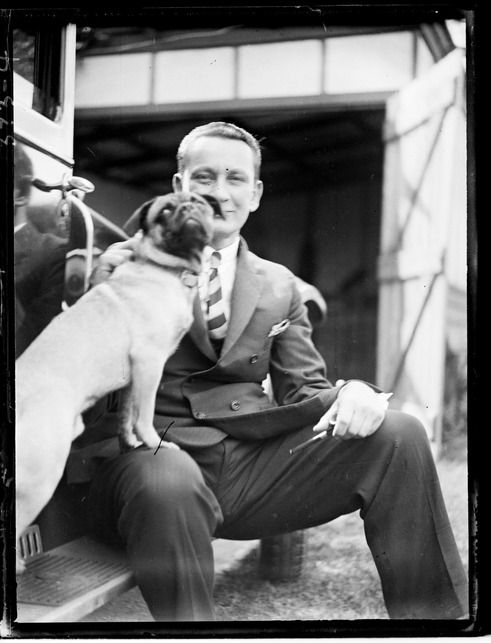 black and white photo of a man and a dog