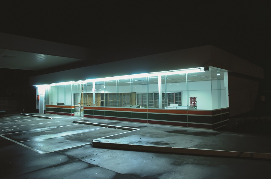 External coloured night image of an abandoned 7 11 store