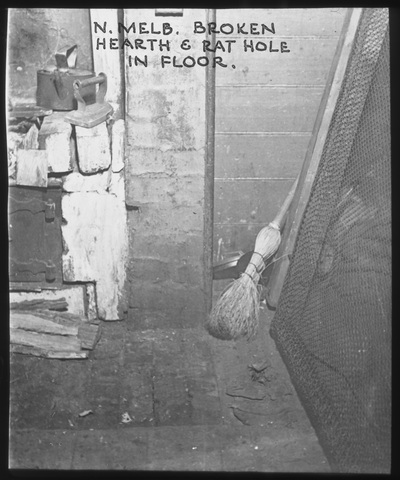 Black and white photo of dirty floor in a 1930s home North Melbourne