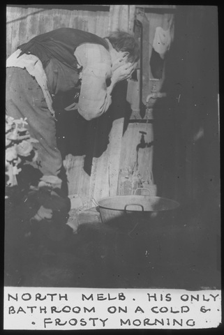 Black and white photo of poor man in 1930s washing face in North Melbourne