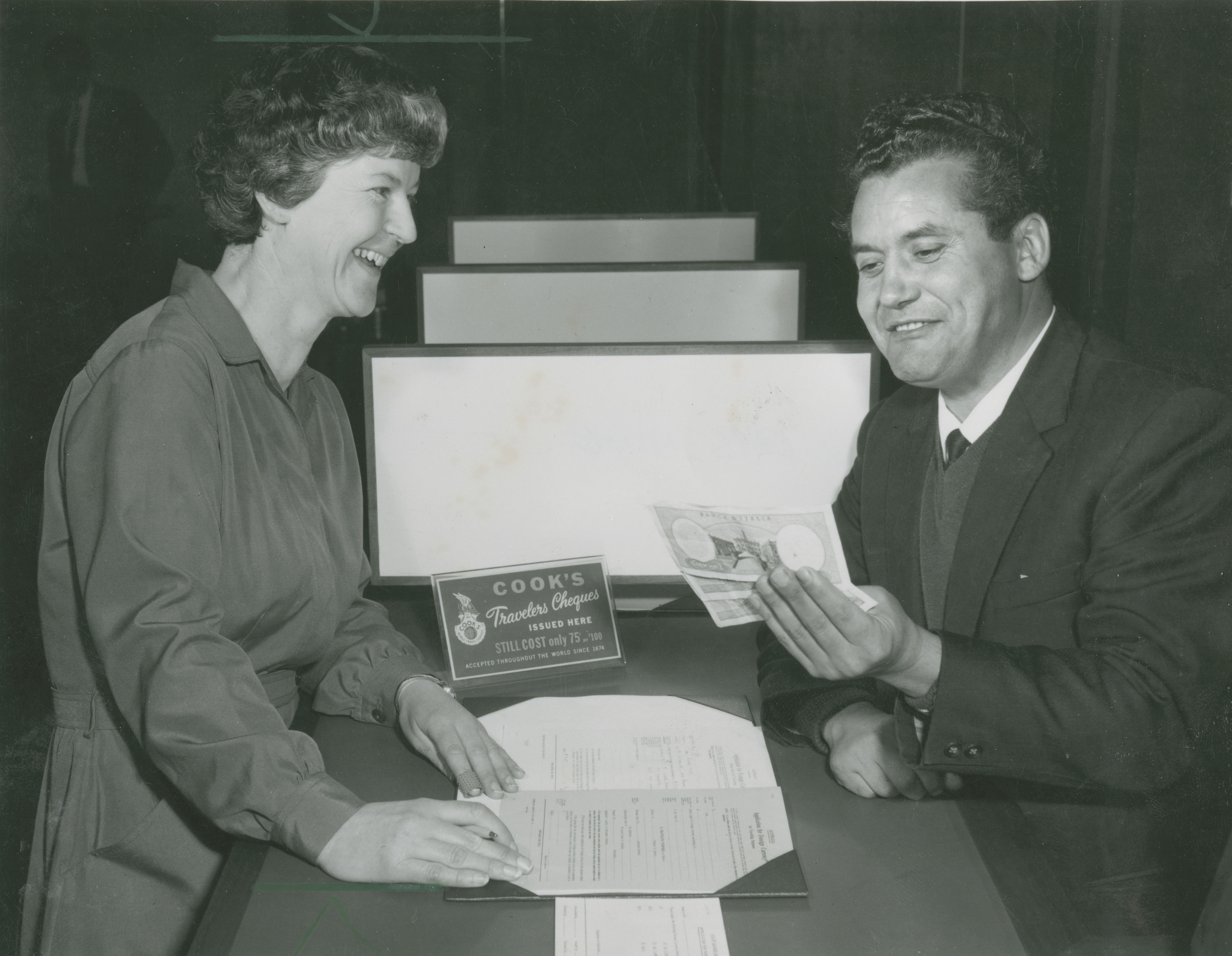 Miss Mac' Stella McDonald of the Overseas Department with a customer.