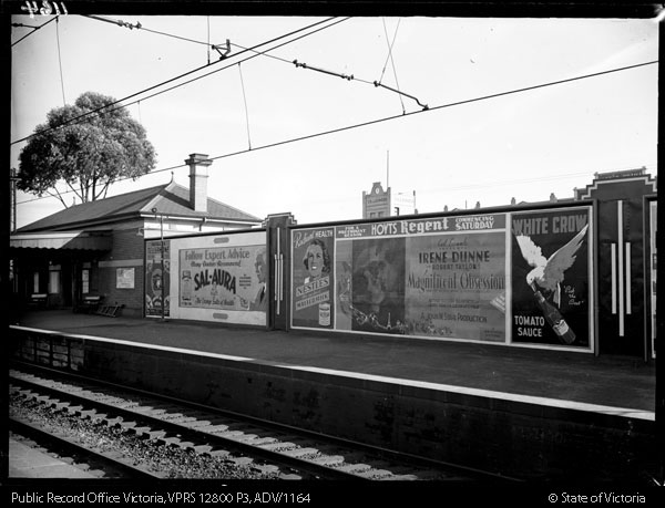 black and white photograph of a billboard