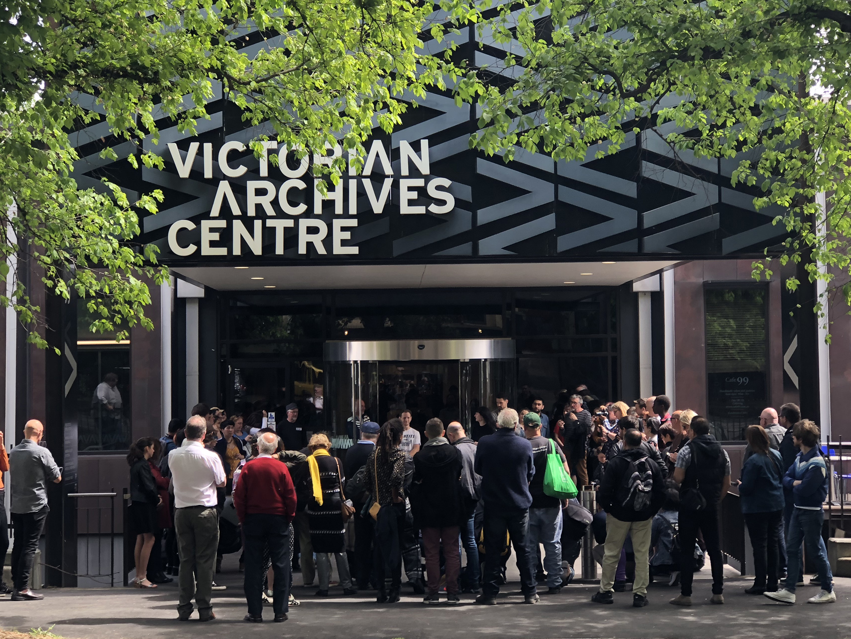 photo of the victorian archives centre building with a crowd standing outside