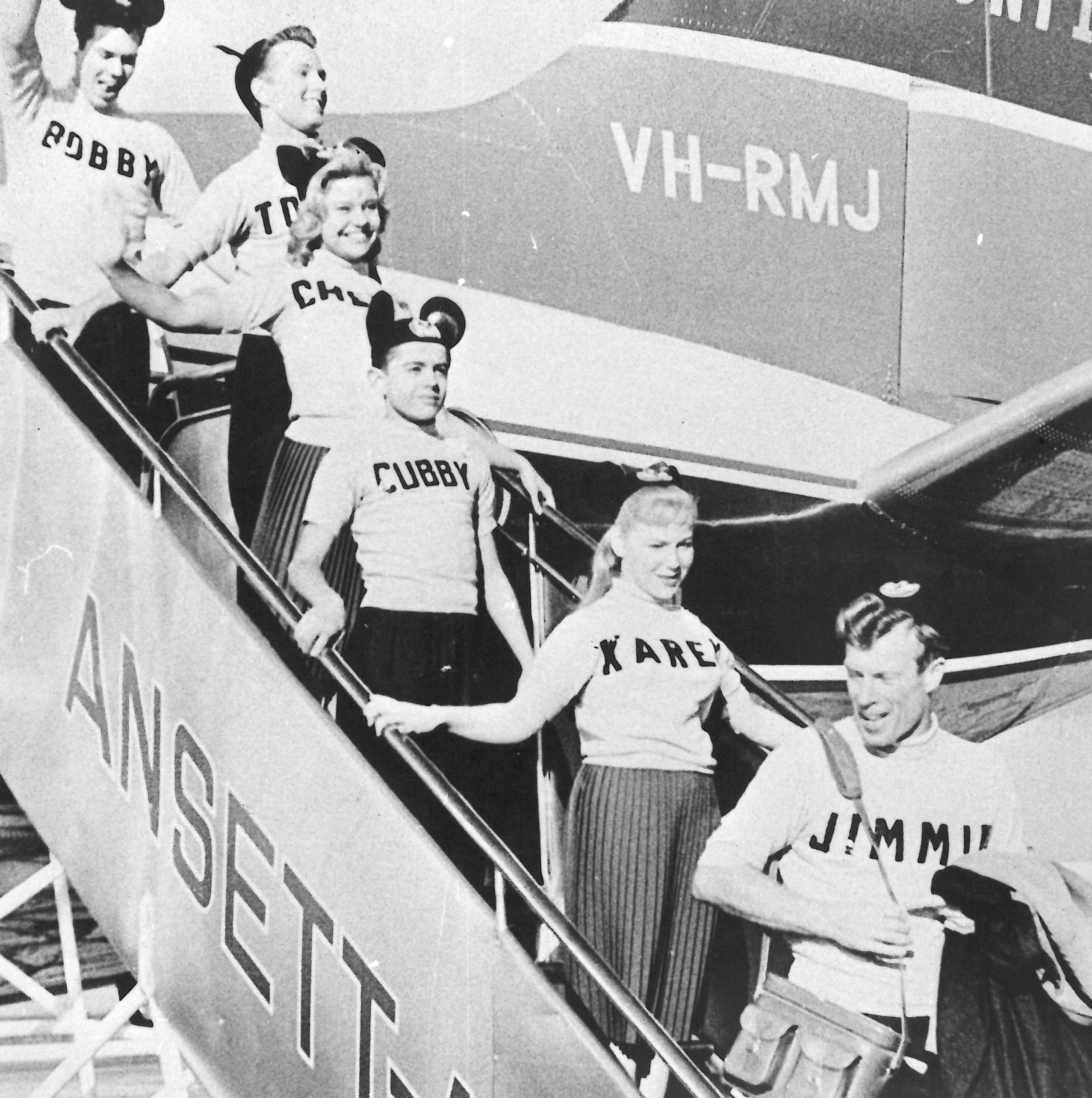 black and white photo of the mouseketeers disembarking the plan