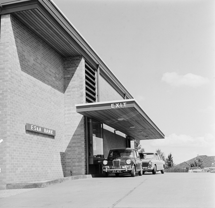 black and white photo of a drive in bank