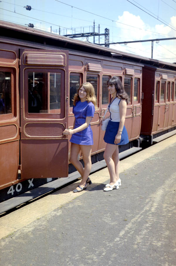 Women in the 1970s getting on a train