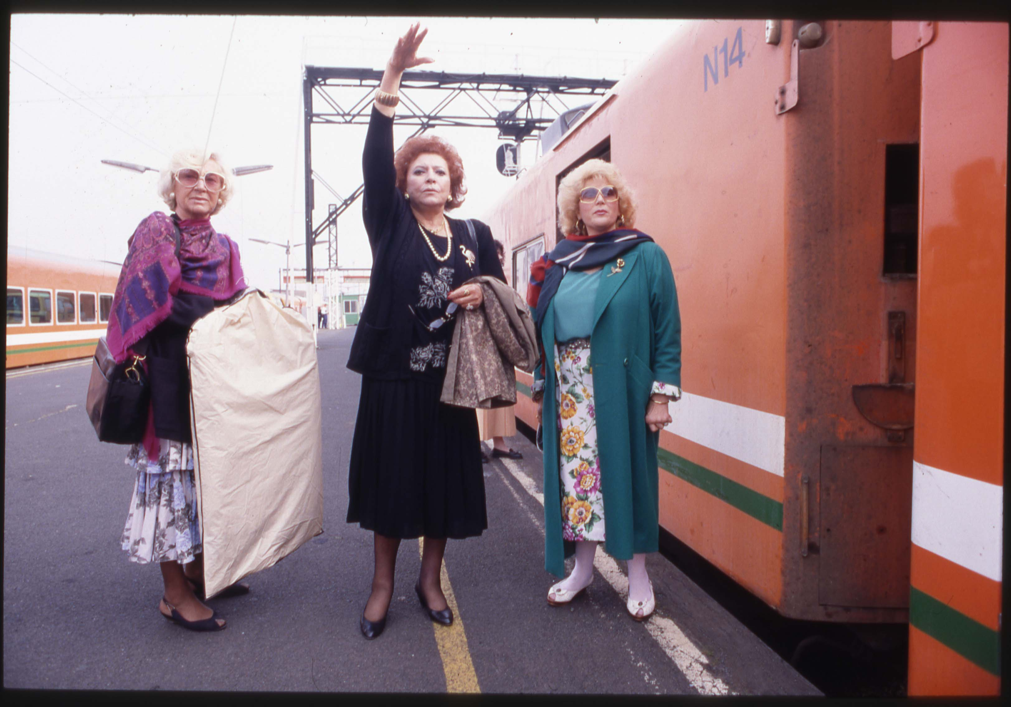 Older women hailing a train