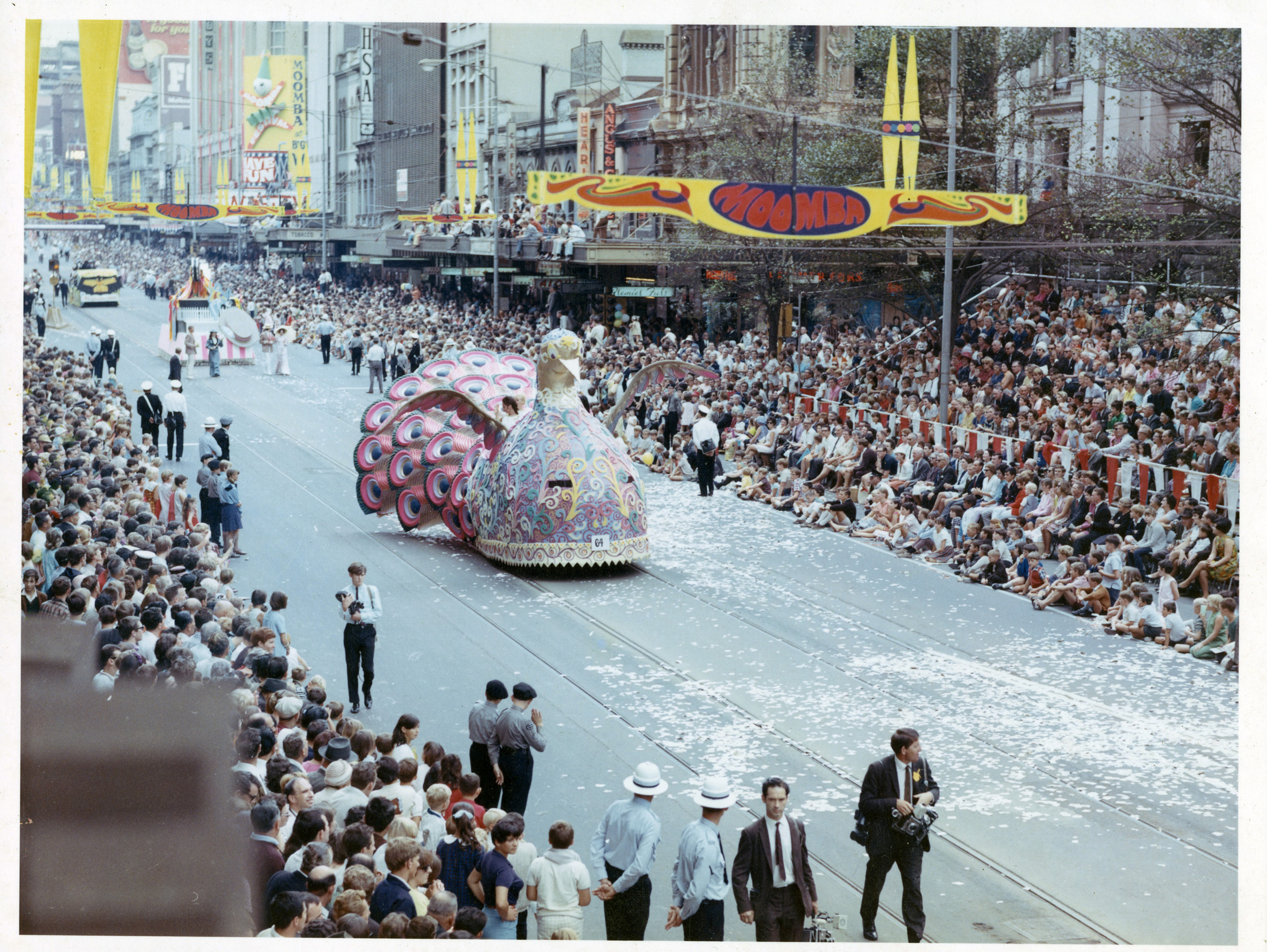 photo of bird float and crowds