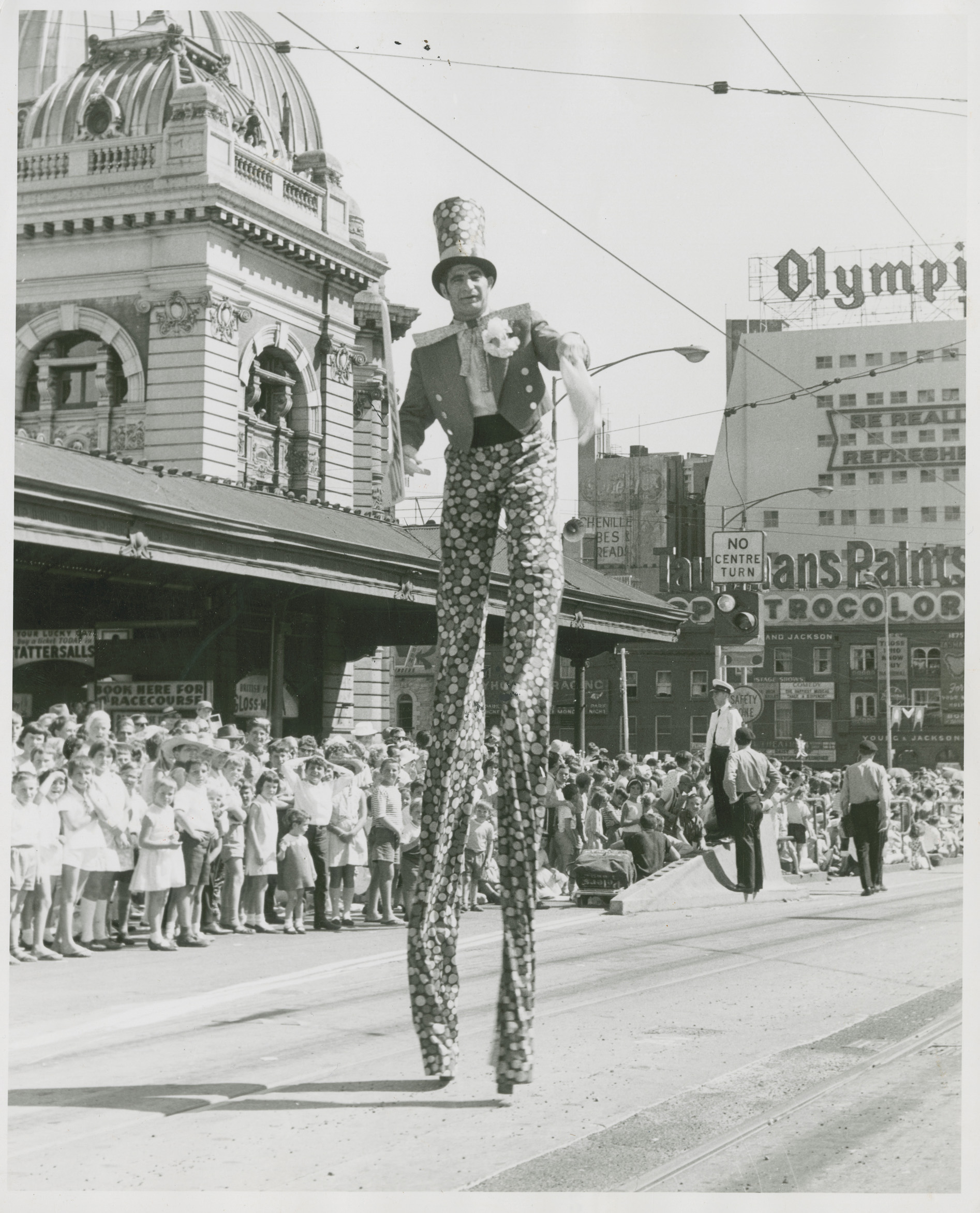 another man on stilts