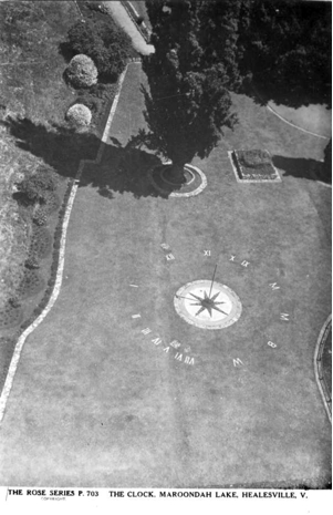 Postcard showing the sundial from the dam wall, circa 1950s.