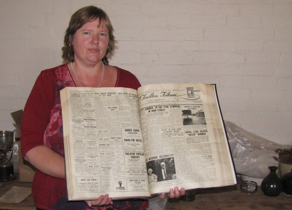 Photo of a woman holding a book