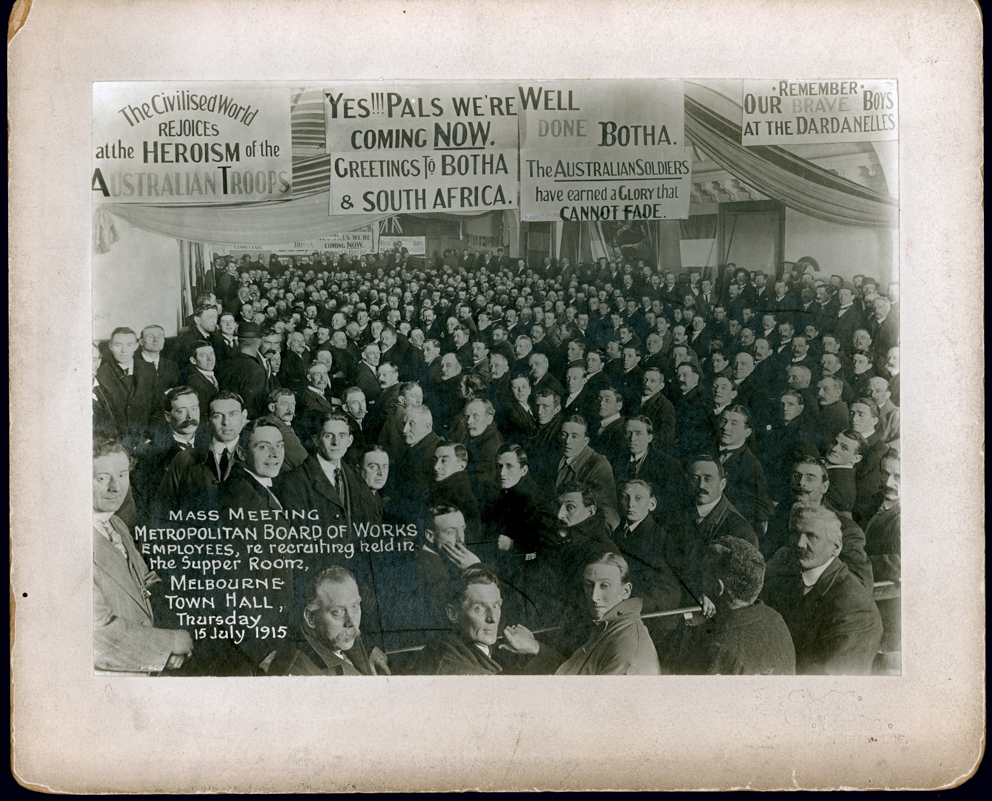 Black and white photograph of World War I recruiting meeting.
