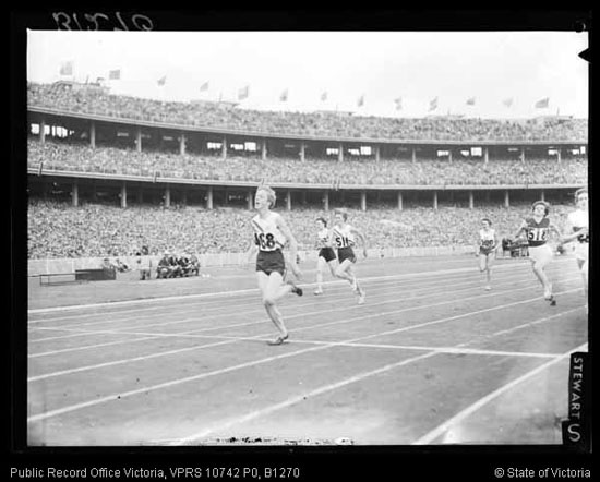 a photo of Betty Cuthbert running around the track