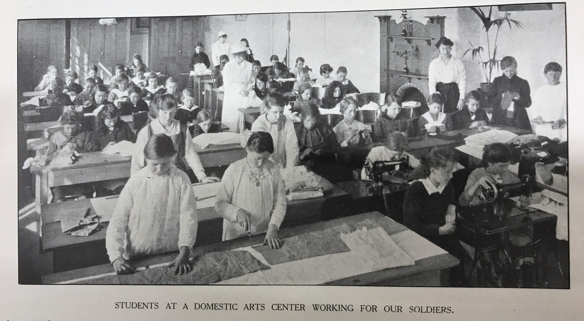 photo of school children working at benches