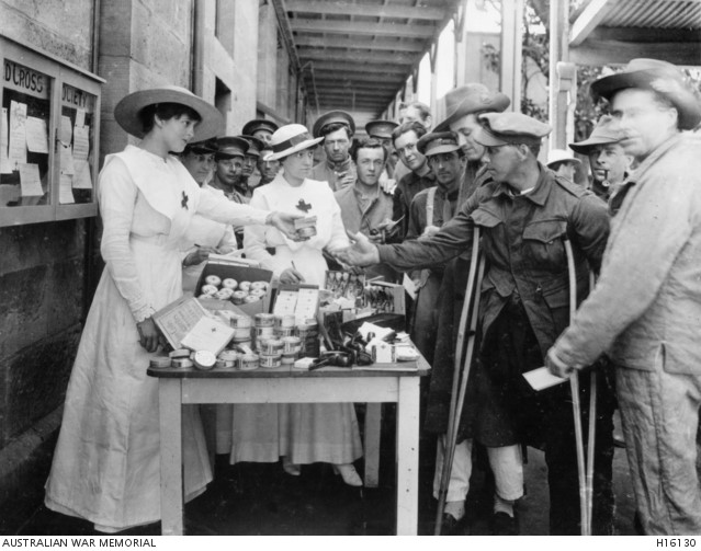 Ladies of the Red Cross Society distributing comforts to wounded men