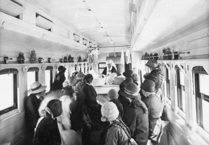 photo of a crowd on a train with their backs to the camera