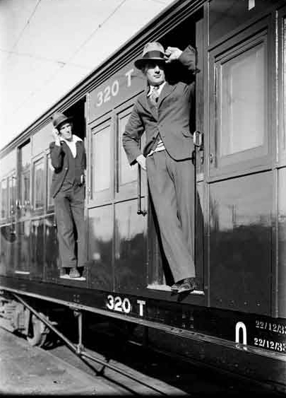 Men Leaning Out of a Train or Tram Carriage
