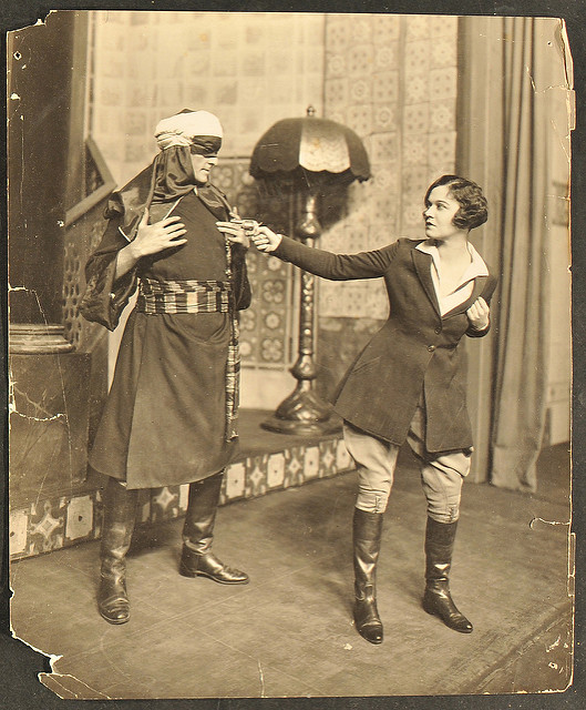 photo from scene book 1 showing two actors on stage