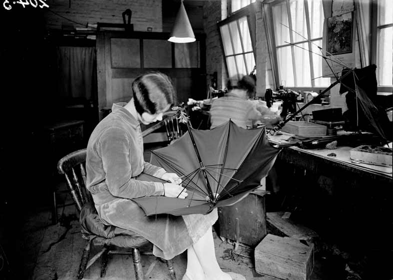 woman making an umbrella in a factory
