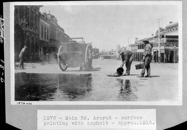 black and white photo of ashpalt being poured on a road
