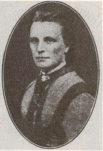 portrait photo of an unsmiling woman