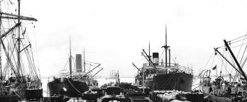 Black and white photo of ships at dock