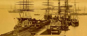 Image of tall ships docked at pier
