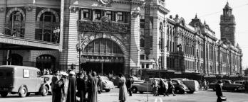 A black and white photo of Flinders Street Station in 1954