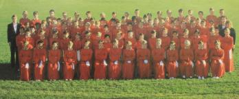 photo of the choir lined up in their red uniforms