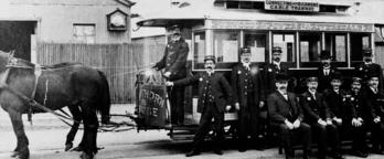 Horse drawn tram and workers 1890