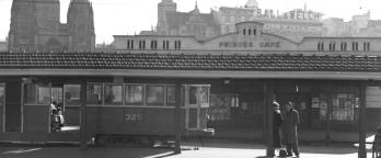 Black and white photo of a tram at a terminus