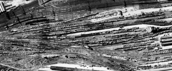 Black and white aerial photo of railyard