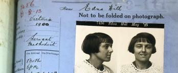 blue piece of paper with a photo of a young woman's face glued on top and name Edna Hill listed at the top of the page
