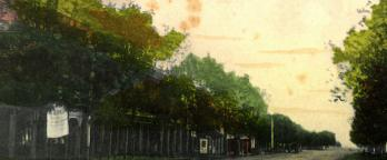 painted scene of a country street at sunset