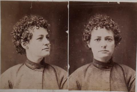 black and white portrait photos of Martha Needle, short curly hair and dark eyes