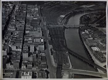 black and white aerial view of flinders street station and rail yards