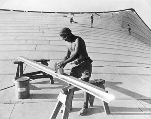 Black and white worker constructs Myer Music Bowl